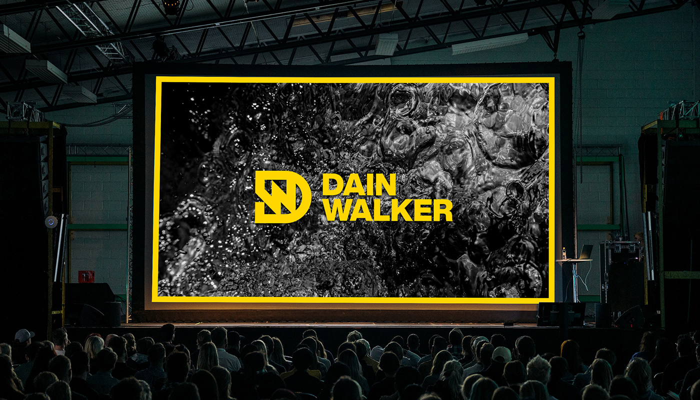 large conference presentation screen with Dain Walker dw letter logo and wordmark branding by connor fowler cfowlerdesign
