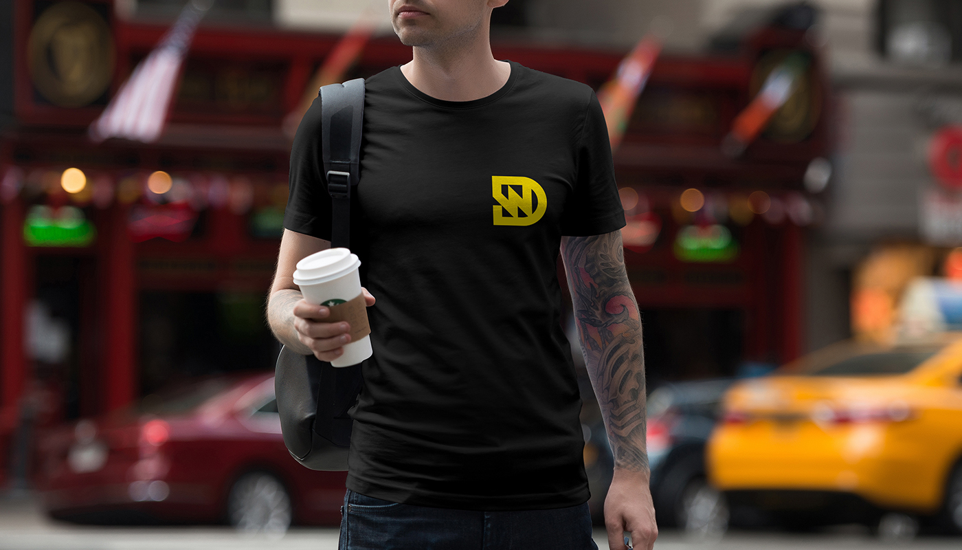 man in black t-shirt with dw Dain Walker logo design printed in yellow by connor fowler cfowlerdesign